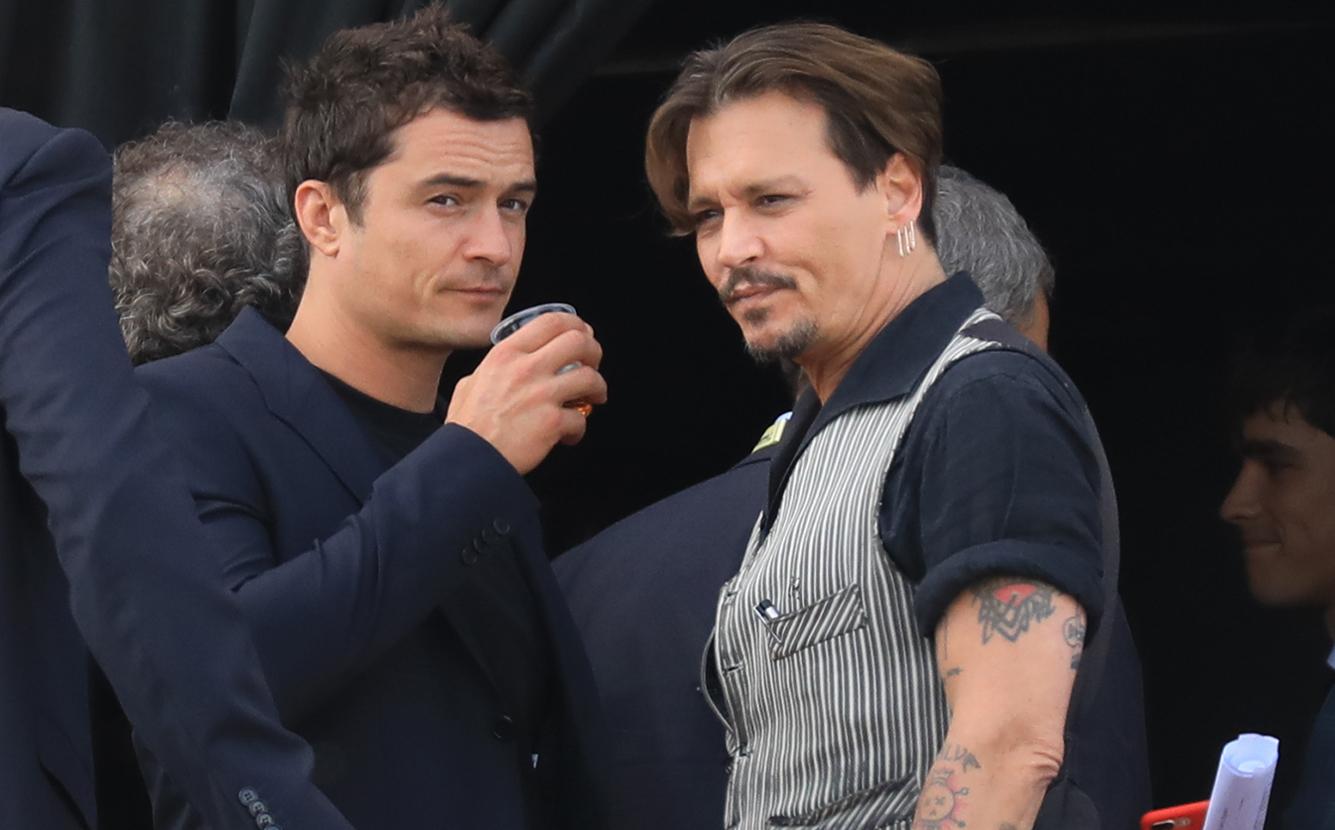 Johnny Depp e Orlando Bloom se reúnem em première de Piratas do ... fa1e2787ec